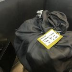 Bag with tags and clothes